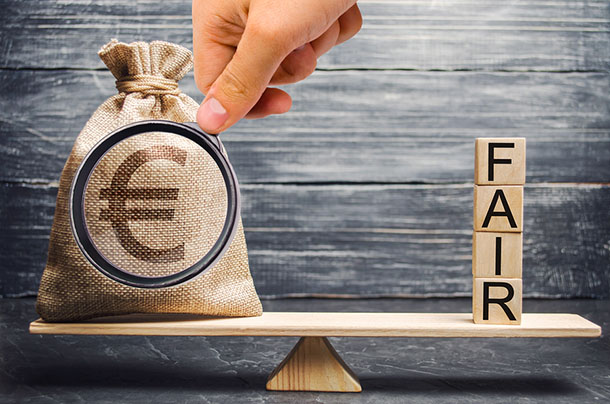 Euro money bag and wooden blocks with the word Fair. Balance. Fair value pricing, money debt. Investment analysis. Fair deal. Reasonable price. Justified risk. Honest loan. Secured loans.